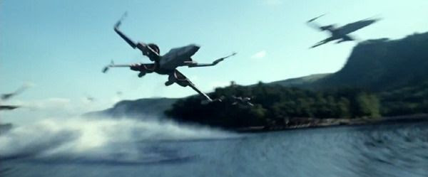 A squadron of X-Wings, part of The Resistance, zooms across a lake in STAR WARS: THE FORCE AWAKENS.