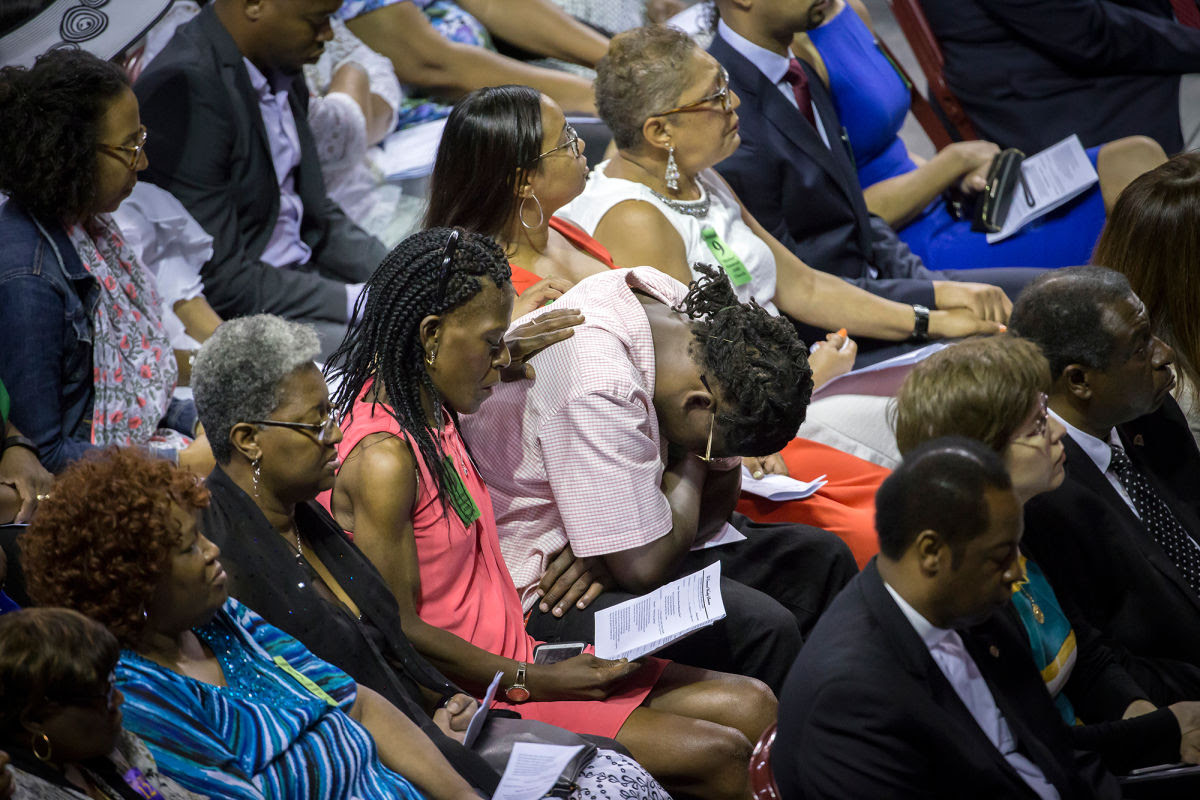 Esther Lance, in pink, during a memorial marking one year after the Emanuel A.M.E. Church shooting. Lance's mother, Ethel Lance, was killed.