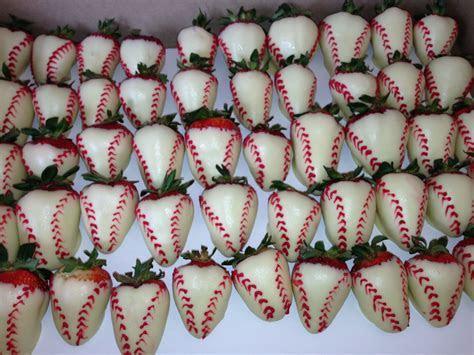 Chocolate covered strawberries decorated like baseballs. #