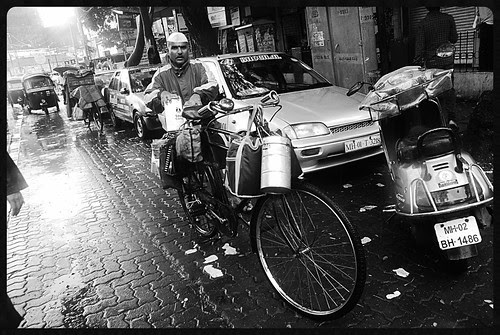 I Would Rather Shoot The Dabbawala in the Rains Than Dumb People At Worli Seaface Getting Wet Without Brains by firoze shakir photographerno1