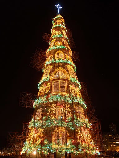 A 85-meter-high floating Christmas tree illuminates