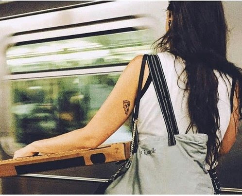 I don't know who this woman is but based on her tattoo and what she's holding, I think she could be the one…
