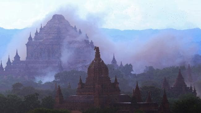 The ancient Sulamani temple is seen shrouded in dust as a 6.8 magnitude earthquake hit Bagan in Myanmar on August 24, 2016. Picture: Soe Moe Aung.