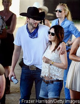Mila Kunis Flashes Baby Bump at Stagecoach Festival With Ashton Kutcher