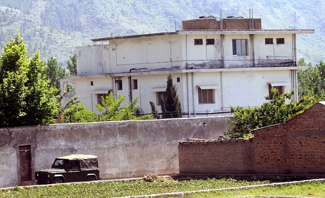 Seen better days: Pakistani soldiers in a jeep pass by the compound, close to a military academy and less than 70 miles from capital Islamabad
