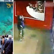 Shocking moment 33-ton shark tank burst in shopping centre injuring 15 people as it sent shards of broken glass and gushing water flying into a crowd