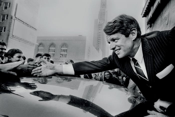 From Photographer's Paradise by Jean-Pierre Laffont. Presidential candidate and New York senator Robert Kennedy greets supporters during a campaign stop in Fort Greene, Brooklyn.