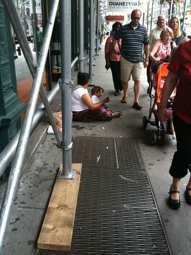 Woman child begging