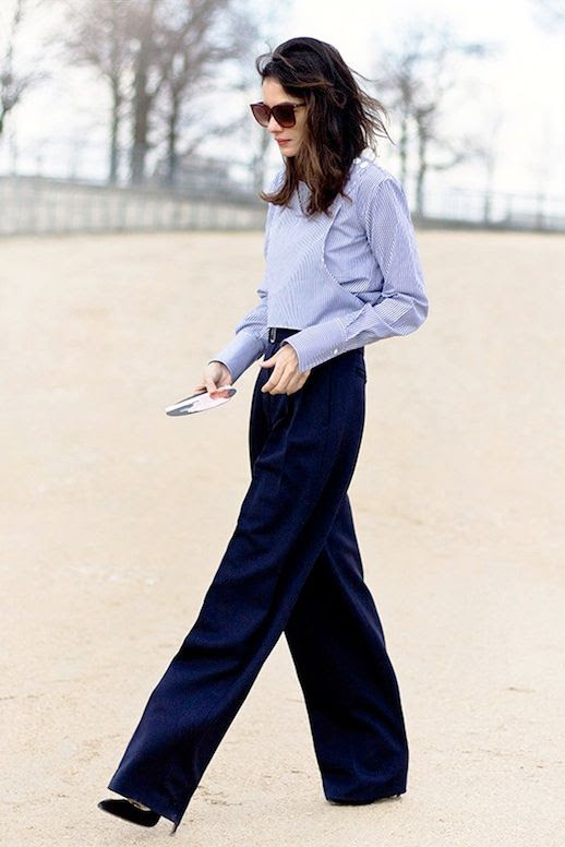 Le Fashion Blog Street Style Sunglasses Leila Javari Blue Striped Shirt High Waisted Wide Leg Trousers Pumps Office Look Via Garance Dore