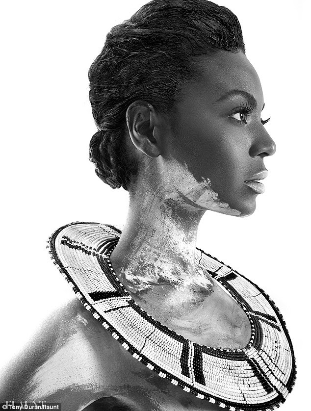 Keeping it simple: In another image, she looks to the side as she wears another African-inspired beaded accessory around her neck