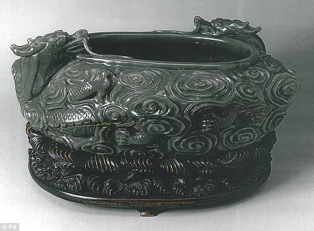 Artefect Durham: An 18th century Chinese jade bowl with a poem inscribed on it, on its wood carved stand
