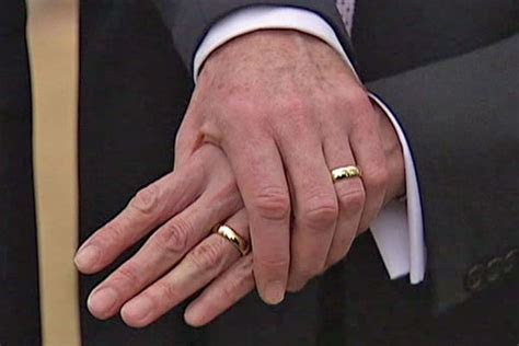 Two men wearing wedding bands holding hands.   ABC News