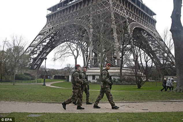 French soldiers patrol next to the Eiffel Tower in Paris; the level of alert regarding terrorism is still at its peak