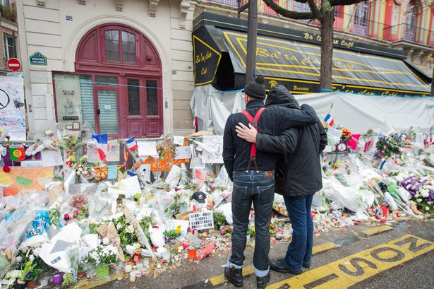 Members of Eagles of Death Metal visit a memorial that pays homage to the victims of the terrorist attacks at Le Bataclan on December 8, 2015