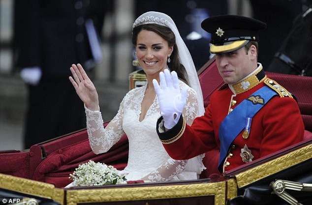 Newly wed: Prince William and his new wife Kate, Duchess of Cambridge, wave as they travel in the 1902 State Landau carriage along the Processional Route to Buckingham Palace