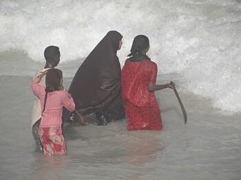 Somalian women carrying weapons to protect themselves from the U.S.-backed military. Women have been abducted and assaulted by the soldiers. by Pan-African News Wire File Photos
