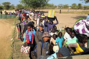 Civilians queue outside the UNMISS compound in Bor,…