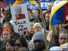 Pro-Tibet demonstrators hold a portrait of the Dalai Lama during protests in Paris