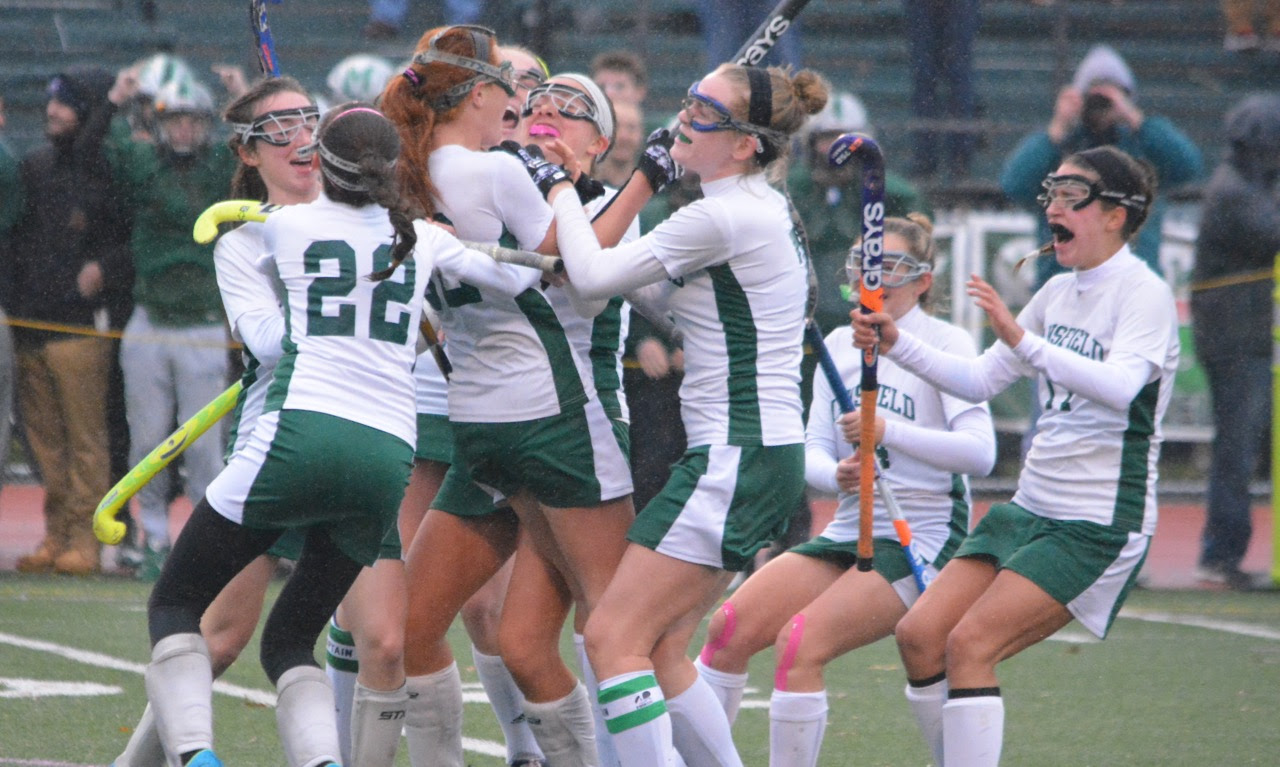 Mansfield celebrates Caitlin Whitman's Last-minute penalty stroke goal that gave the Hornets a win in the Div. 1 South semifinal against Franklin. (Josh Perry/HockomockSports.com)