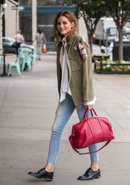 Le Fashion Blog Olivia Palermo In New York Army Jacket Bow Blouse Skinny Jeans Black Brogues Red Duffle Bag Via Vogue