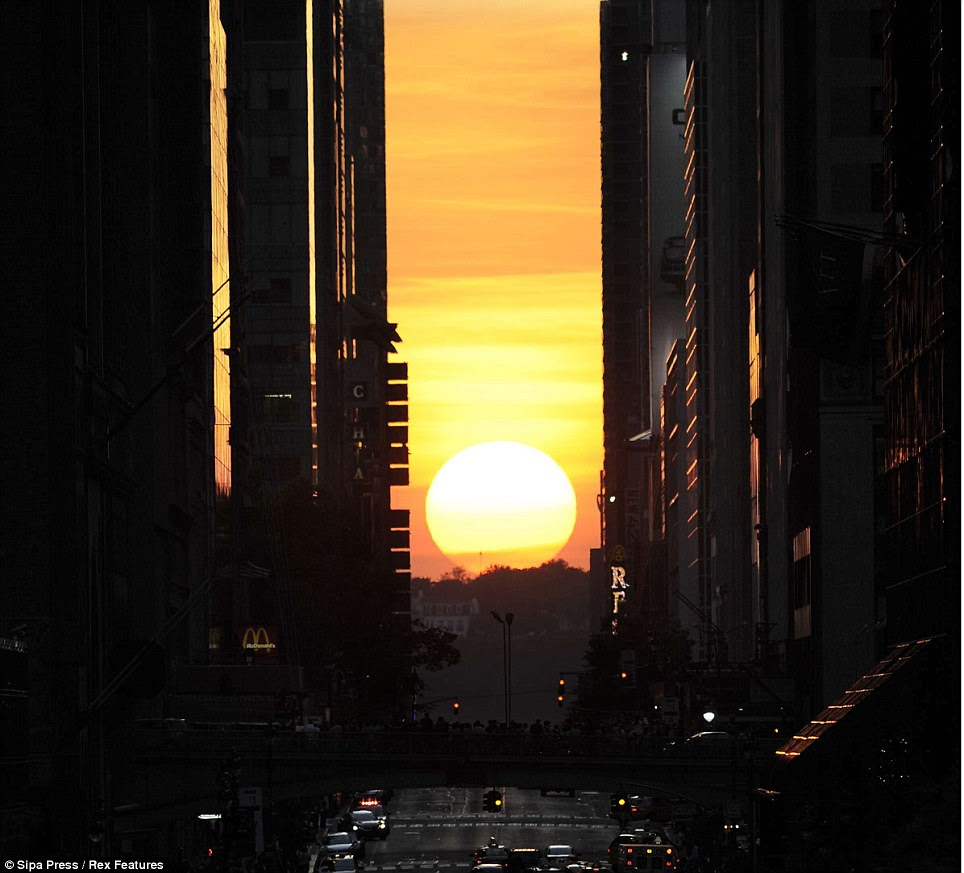 Beautiful: This occurs in Manhattan due to a clear view to the horizon beyond the grid - across the Hudson River to New Jersey - as well as the tall buildings that line the streets, creating a vertical channel to frame the sun