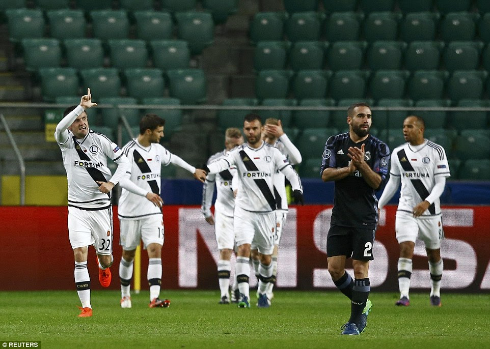 Miroslav Radovic races away to celebrate after equalising for Legia Warsaw after 57 minutes of the match