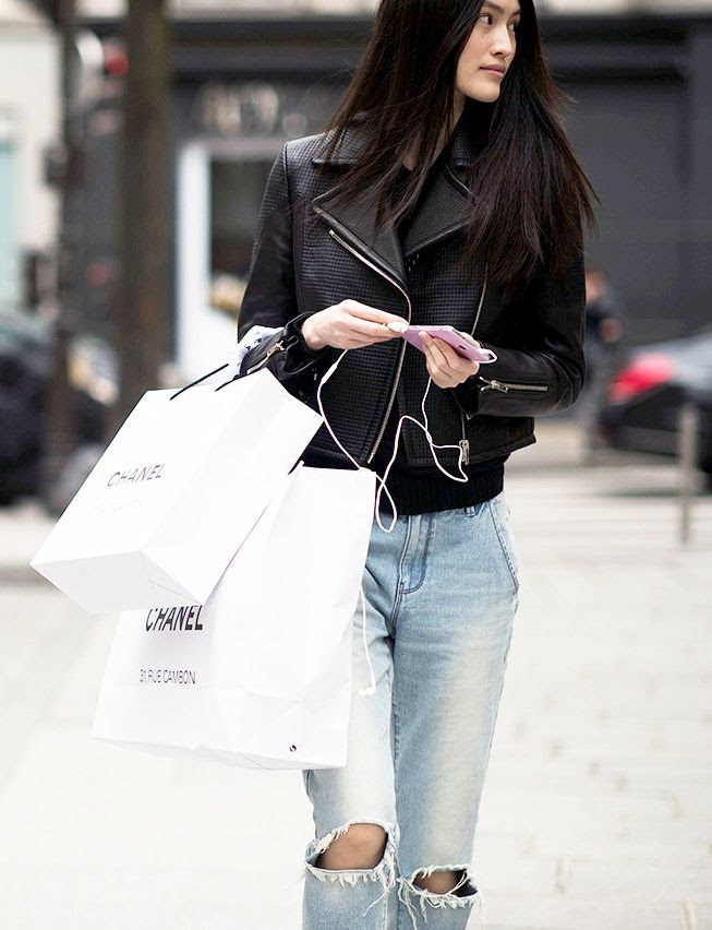 Le Fashion Blog Best Black Friday Cyber Monday Sales Model Street Style Leather Moto Jacket Ripped Boyfriend Jeans Via Adam Katz Sinding Le21eme