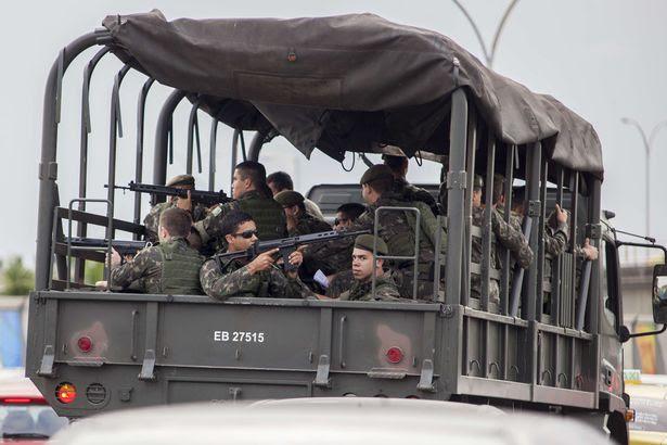Brazilian Army truck passes by Complexo da Mare