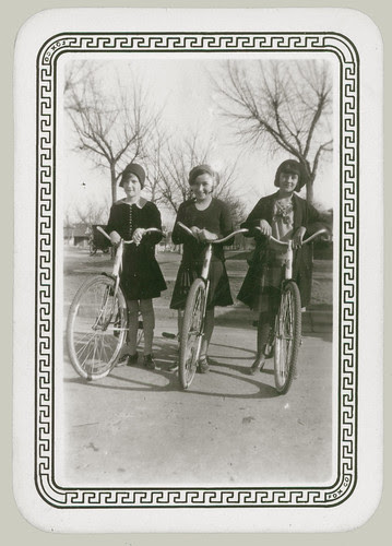 Three girls on bikes