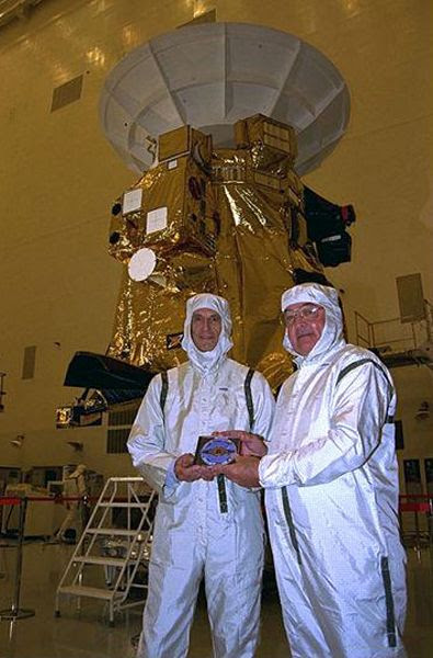 Former Cassini-Huygens mission team members Charley Kohlhase (left) and Richard Spehalski pose with the DVD at NASA's Kennedy Space Center in Florida...prior to Cassini's launch on October 15, 1997.