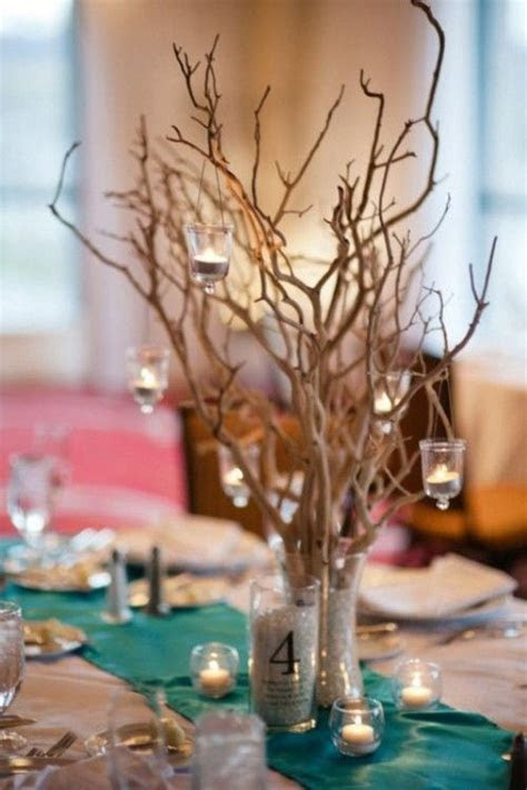 hanging candles from branches rustic beach wedding