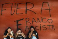 "Supporters of Paraguay's ousted President Fernando Lugo eat chicken against a wall spray painted with a message that reads in Spanish: ""Out Franco, fascist, "" referring to Paraguay's newly named President Federico Franco, in Asuncion downtown, Paraguay, Tuesday, June 26, 2012. Lugo said Monday that he is aiming to return to power and will rally allies at home and abroad after a landslide congressional vote forced him from office in what he called a break with democracy. Lugo has symbolically created a parallel Cabinet, attacking the legitimacy of the government that replaced him. (AP Photo/Jorge Saenz)"