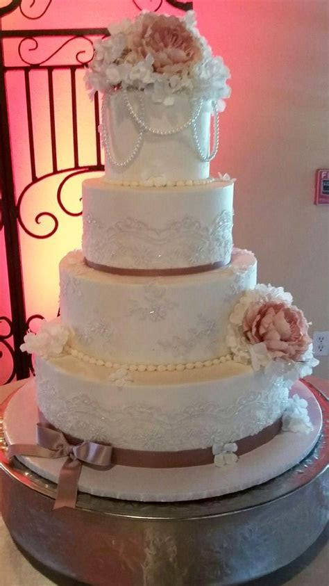 Four tier vintage lace wedding cake with rose peonies