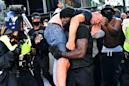 A picture and its story: Black personal trainer carries suspected far-right protester to safety