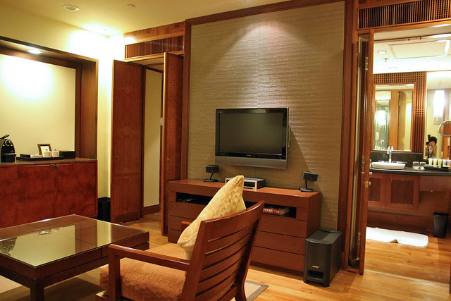 32-inch LCD TV and living area, plus bathroom entrance