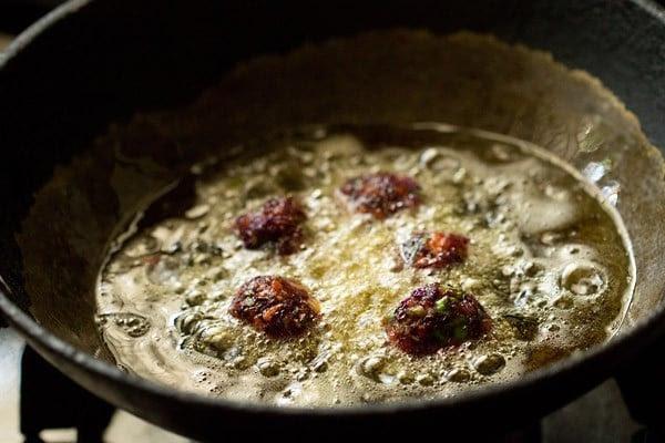 frying vegetable manchurian balls