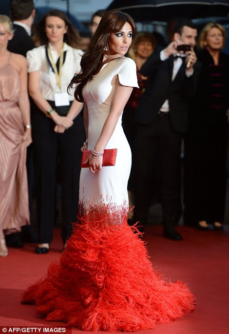 Ruffling feathers: Cheryl's impressive gown stole the limelight from the other stars at screening of Amour