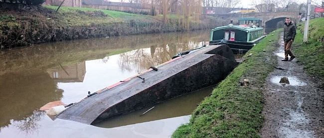 Capsized boat near Bingley Arms