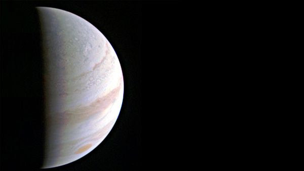 An image of Jupiter that was taken by NASA's Juno spacecraft on August 27, 2016...from a distance of 437,000 miles (703,000 kilometers).