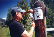 Photo of Executive Director Brooks Fahy posting flyer