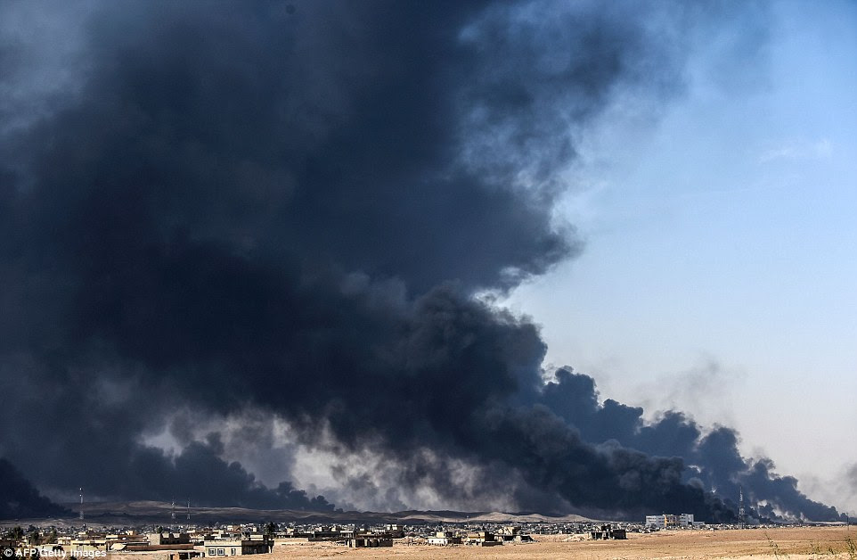 ISIS radicals have begun setting fire to oil wells as they flee Mosul - with striking similarities to Saddam Hussain's defeated troops 25 years ago
