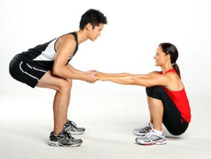 5. Partner squats