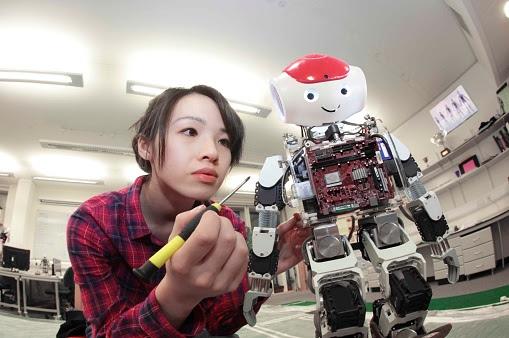 female student building robot : Stock Photo