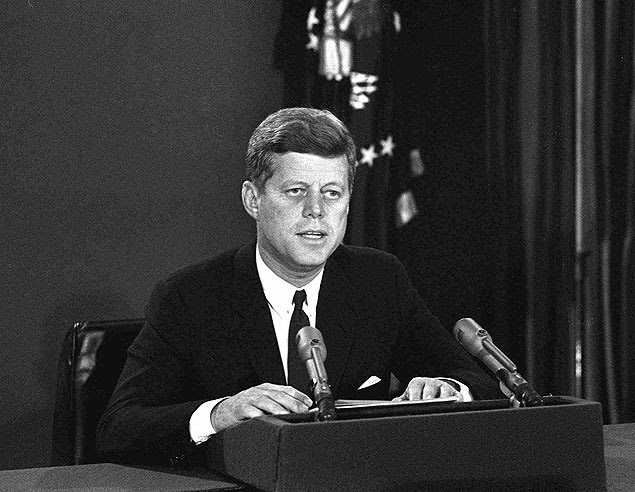 """FILE - In this Oct. 22, 1962 file photo, President John F. Kennedy makes a national television speech from Washington. He announced a naval blockade of Cuba until Soviet missiles are removed. The Kennedy image, the """"mystique"""" that attracts tourists and historians alike, did not begin with his presidency and is in no danger of ending 50 years after his death. Its journey has been uneven, but resilient _ a young and still-evolving politician whose name was sanctified by his assassination, upended by discoveries of womanizing, hidden health problems and political intrigue, and forgiven in numerous polls that place JFK among the most beloved of former presidents.(AP Photo) ORG XMIT: NY308"""