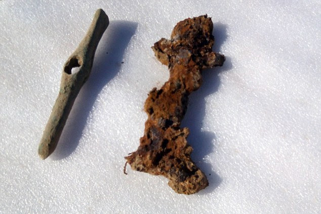 A bronze chisel  and an iron Scythian sword (pictured) were found in the tomb with the warrior. The researchers also found the remnants of a leather belt, a belt made with several types of metal and other iron fragments