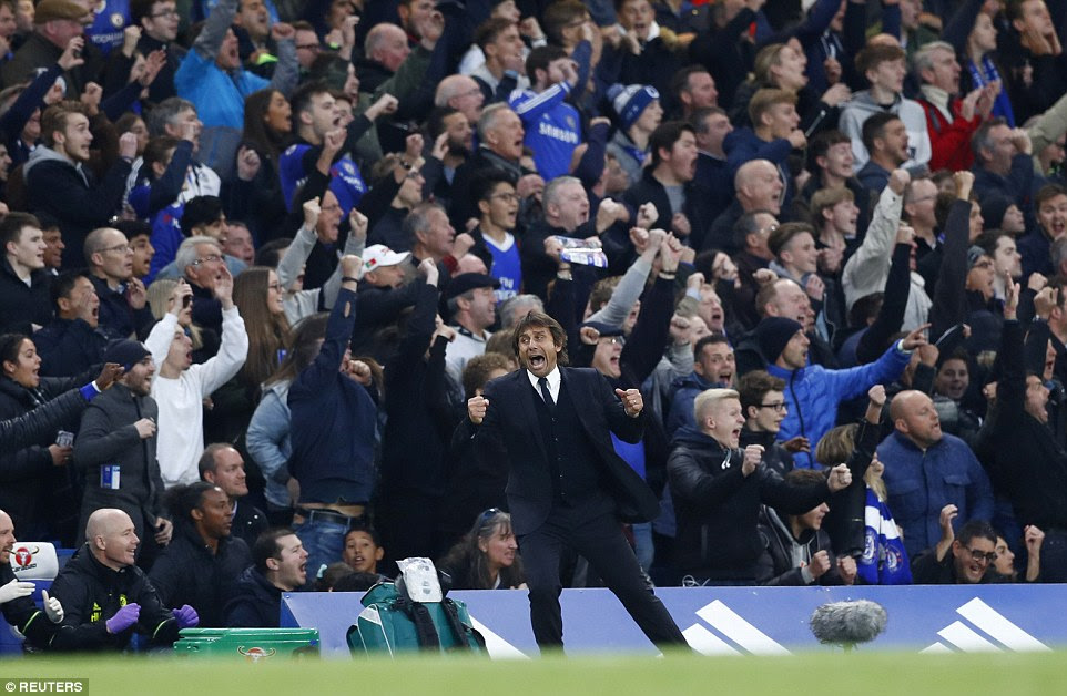 Conte turns around to celebrate as the Chelsea fans celebrate another goal against Manchester United