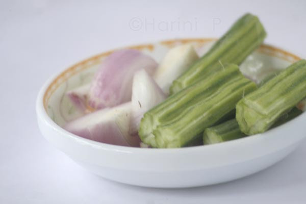 Arachhu utta sambar with onions and drumsticks chopped