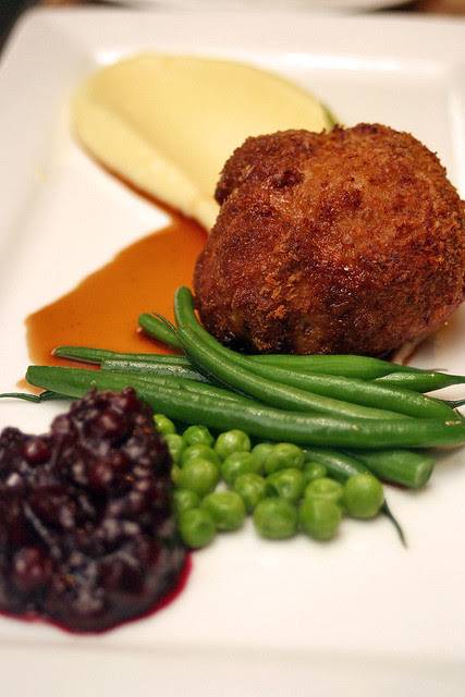 Veal Wallenberger with Yukon mash, French beans, green peas, crushed lingonberries and red wine sauce