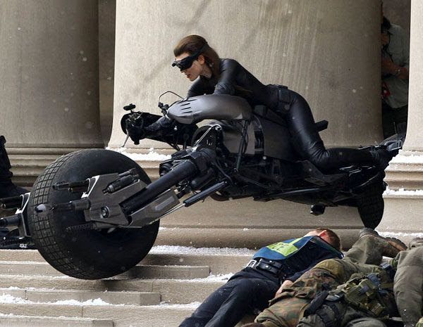 A stunt double dressed as Catwoman rides the Batpod during filming of THE DARK KNIGHT RISES.