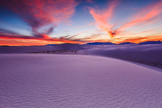 #Sunset casts incredible colors on an ocean of sand dunes at White Sands NPS, #NewMexico | Photography by ©Hongxun Gao.
